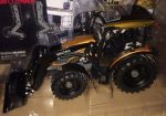 Valtra A104 with front loader, brown
