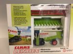 Claas Lexion 460 combine on tracks with grain header and maize head